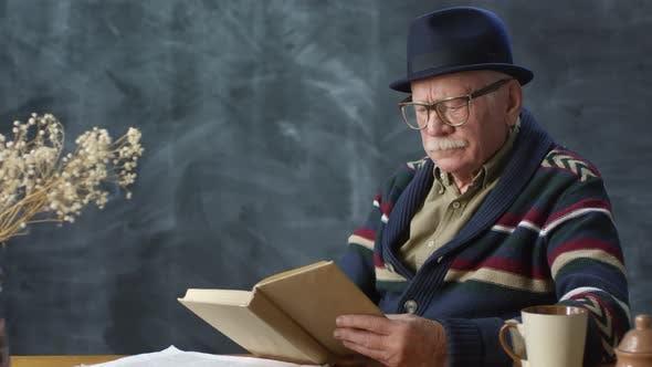 Thumbnail for Elegant Elderly Man Reading Book