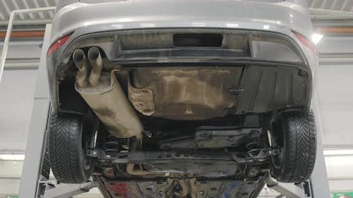 Car Is Lifting In Automobile Service For Repairing.