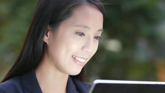 Thumbnail for Businesswoman use of digital tablet computer