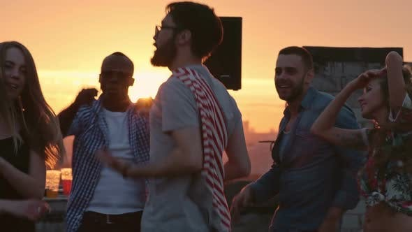 Thumbnail for Party Friends Dancing on Rooftop at Sunset