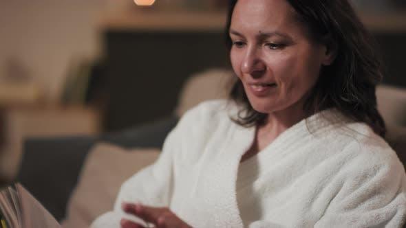 Thumbnail for Woman In Bathrobe Reading Book