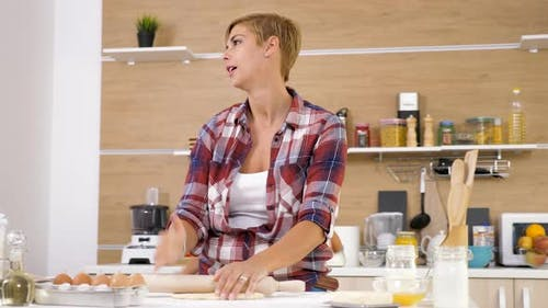 Mother Working at the Kitchen While Her Daughter Distracts Her