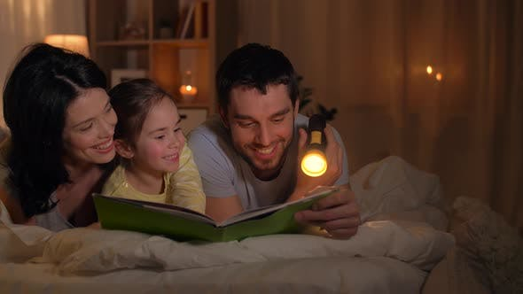 Thumbnail for Happy Family Reading Book in Bed at Home 30