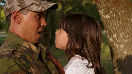 Happy Military Daddy Holding Little Daughter in Arms