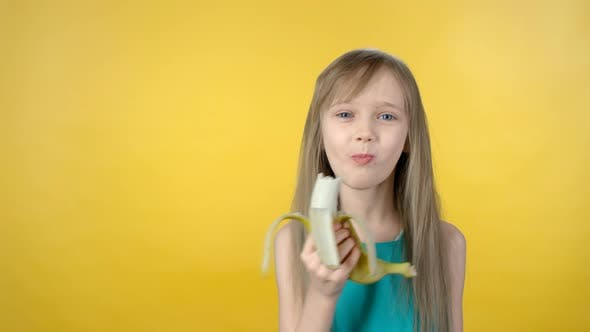 Cover Image for Cute Girl Eating Banana