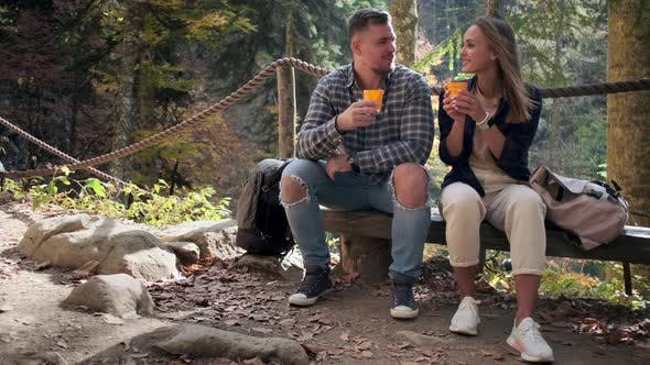 Couple Having a Romantic Date in the Wood