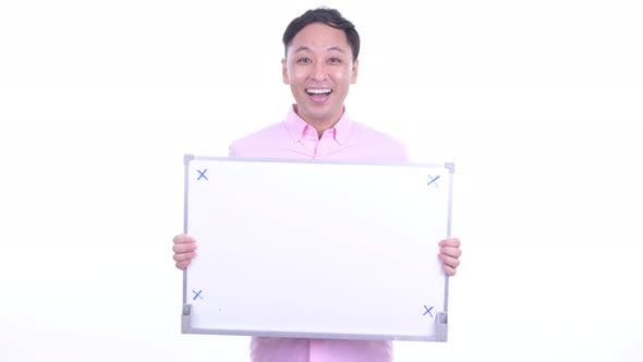 Thumbnail for Happy Japanese Businessman Talking While Holding White Board