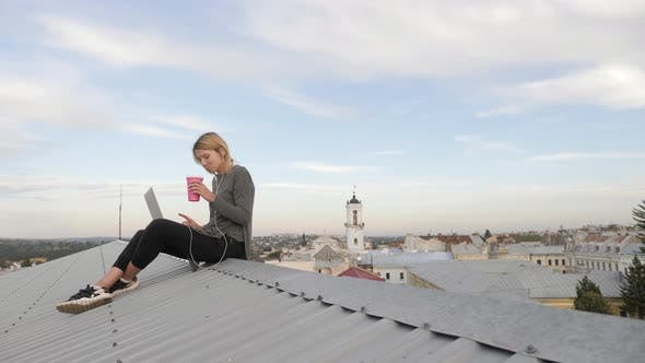 Thumbnail for Woman drinking coffee on the rooftop