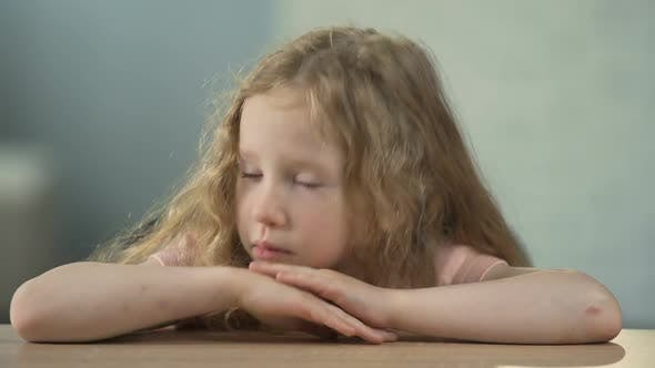 Sad Little Girl Sitting at The Table and Crying, Children's Abuse, Loneliness