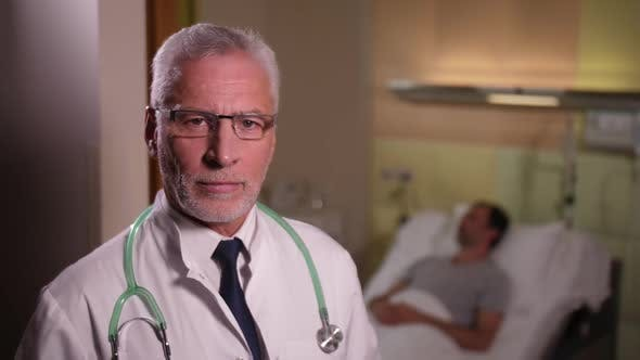 Thumbnail for Portrait of Serious Aging Doctor in Patient's Ward