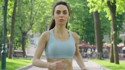 Woman Jogging with Earphones in the Morning