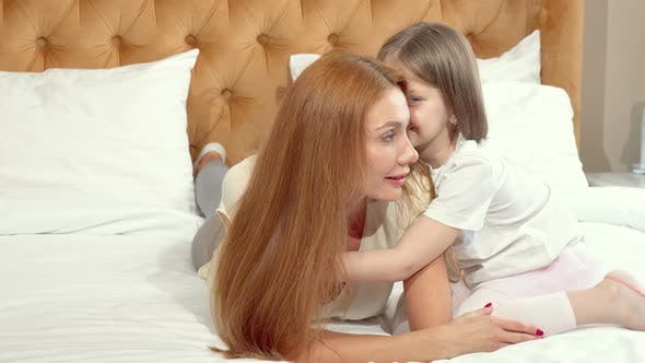 Thumbnail for Cute Little Girl Enjoying Resting at Home with Her Mother