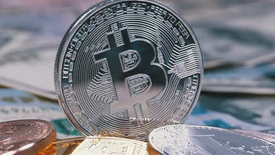 Silver Bitcoin Coin, BTC and Bills of Dollars Are Rotating