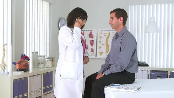 Thumbnail for Asian doctor using stethoscope