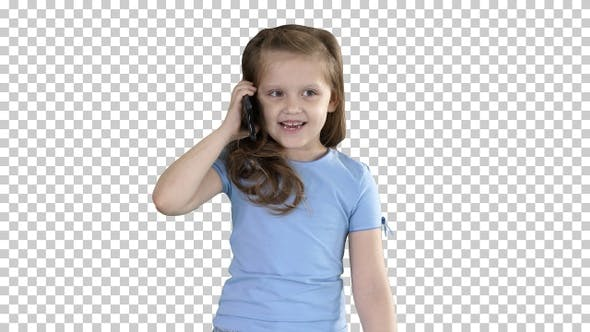 Thumbnail for Little cute girl making a phone call while walking, Alpha Channel
