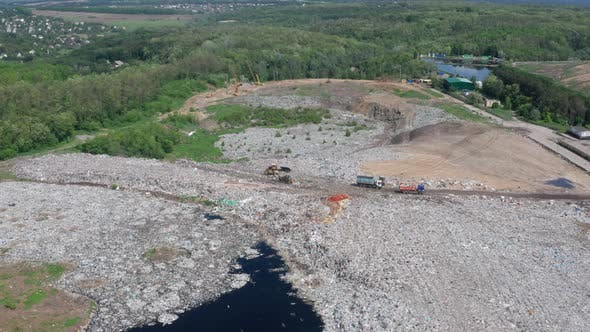Thumbnail for Drone Shot of Dump Trucks Working on City Landfill