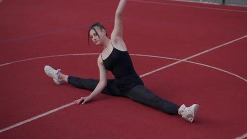 Woman Gymnast Doing Twine.