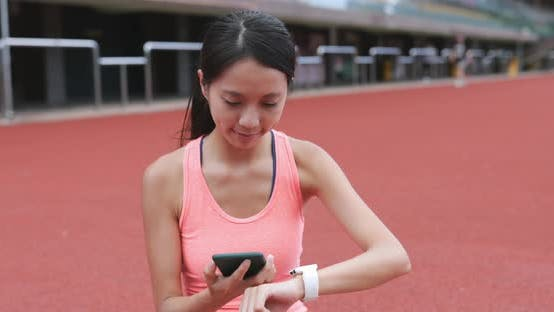 Thumbnail for Sport woman using smart watch and conecting to smart watch in sport complex