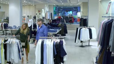 Excited Shoppers in Clothing Shop