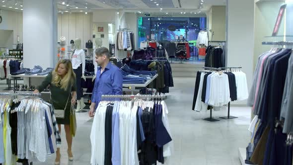Thumbnail for Excited Shoppers in Clothing Shop