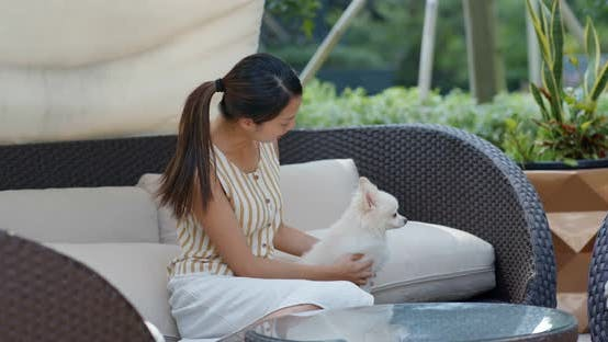 Thumbnail for Woman go resort hotel with her dog
