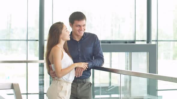 Thumbnail for Young Businessman with a Wife Choose the Car in Showroom