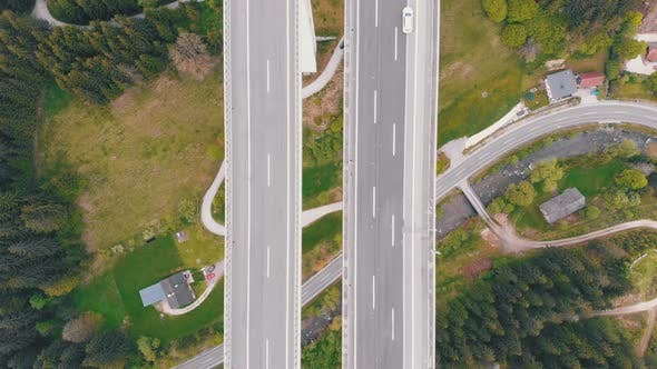 Thumbnail for Aerial Top View of Highway Viaduct with Multilane Traffic in Mountains, Autobahn in Austria
