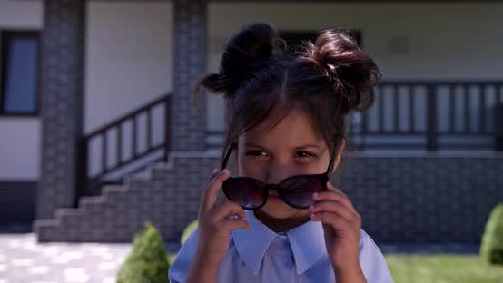 Little Girl Presents Designer Summer Clothes And Accessori