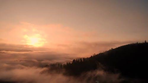 Foggy Sunrise in Mountains