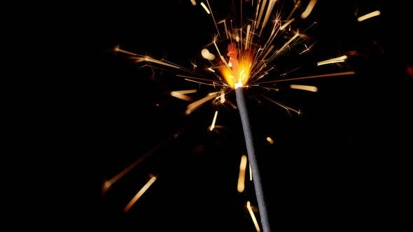 Thumbnail for Bengal Fire Sparkling Lights Burning in Front of Black Background Closeup  Footage Slow Motion