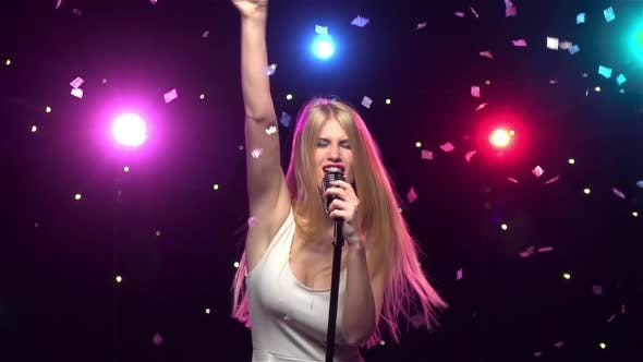 Cover Image for Blonde Girl Singing and Dancing with Retro Microphone
