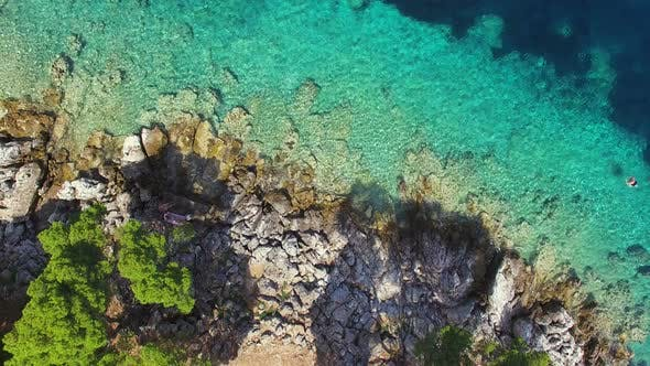 Aerial view of turquoise shallows contrasted with deep sea