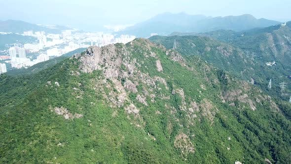 Cover Image for Drone flying up to lion rock mountain