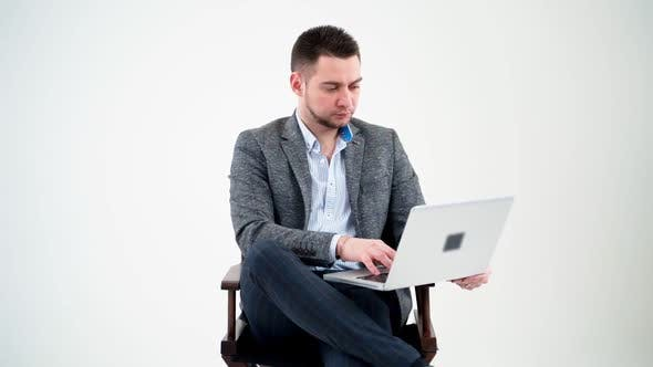 Thumbnail for Portrait of serious businessman with a laptop