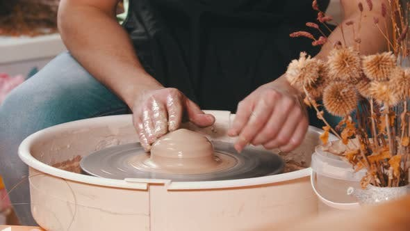 Pottery - Potter Master Is Working with Clay on a Potter's Wheel in Workshop