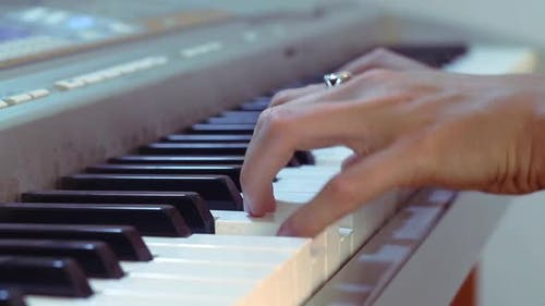 Hands And Piano Keys