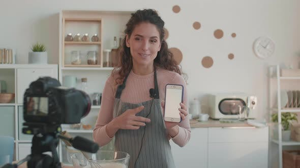 Thumbnail for Woman Showing Recommendations on Smartphone