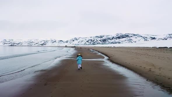Thumbnail for Girl running along the sea