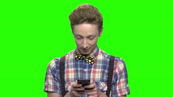 Fashionable Teen Boy Texting on Smartphone