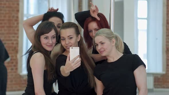 Thumbnail for Group of Young Women Taking a Selfie During a Break on a Pole Fitness Class