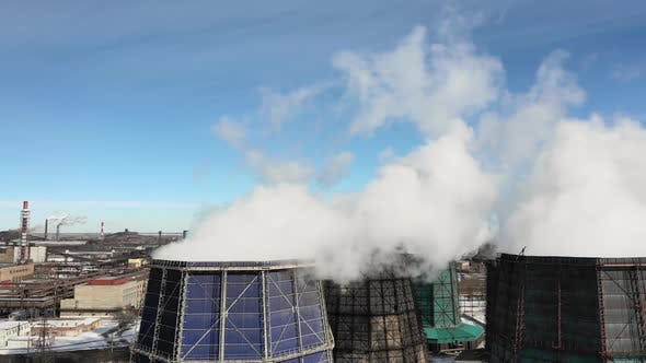 Industrial Smoke Stack Pipes Pollute Air with Toxic Emissions