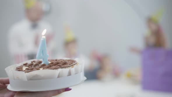 Thumbnail for Camera Following Birthday Cake To the Table with Family in Party Hats, Mother Bringing Pie with