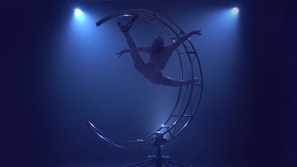 Thumbnail for Aerial Acrobatics the Girl Weighs in a Twine on a Design in the Form of a Month and She Turns. Blue