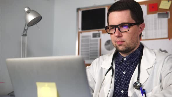 Thumbnail for Doctor of a Private Clinic Prints the Text on the Laptop in His Private Office