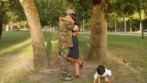Military Man Enjoying Reunion with Family