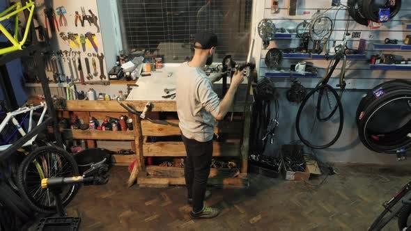 Thumbnail for Mechanic repairing a bike fork