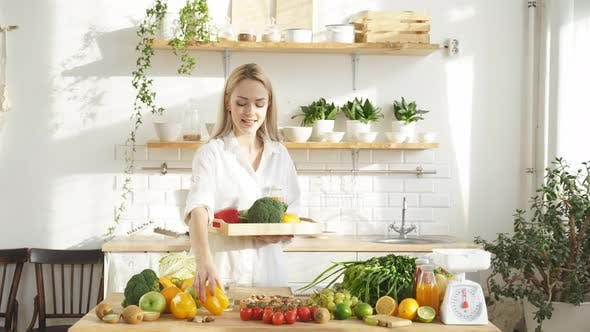 Female Food Blogger Tells the Camera What you Can Cook in the Kitchen with Fresh Vegetables