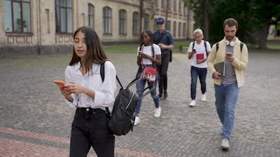 Addicted to Gadgets Students Walking Outdoors