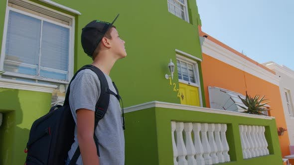 Boy Tourist in Cape Town BoKaap Malay Area Perspective of Cobble Stone Street Colored Terrace Houses