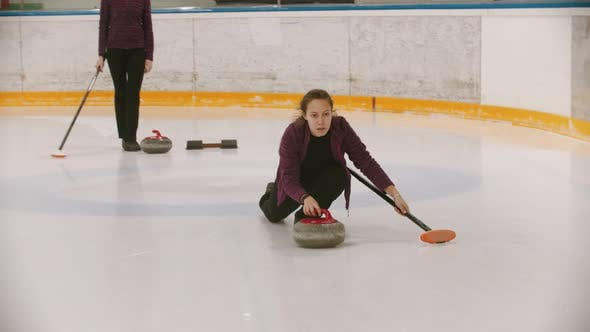 Thumbnail for Curling Training in the Sport Complex - Woman Skating on the Ice